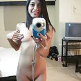 Cute Asian teen tries out some nude mirror selfies - image 2